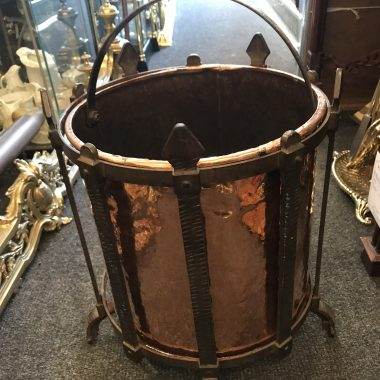 his is a superb quality Arts & Crafts copper t coal scuttle which is a very top quality piece is a very unusual shape, it is in style the same as most enclosed coal scuttles and has the added advantage of retaining it original shovel which fits neatly into the front of the bucket.