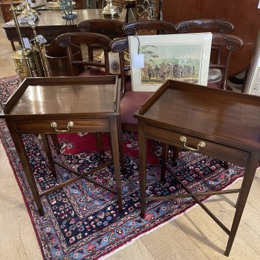 A GOOD QUALITY PAIR OF 20TH CENTURY MAHOGANY SIDE TABLES, each with a three quarter raised gallery, over a single drawer having a decorative brass handle, raised on tapered legs united with a 'x' stretcher,